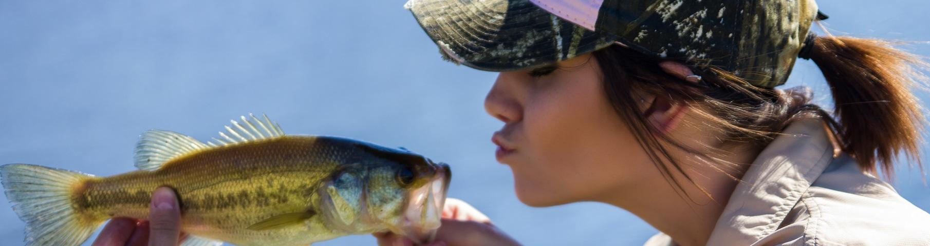 girl kissing fish