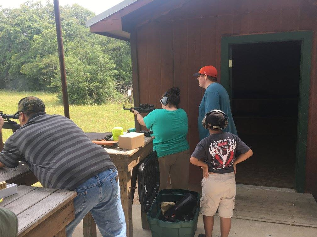 families at outdoor shooting range