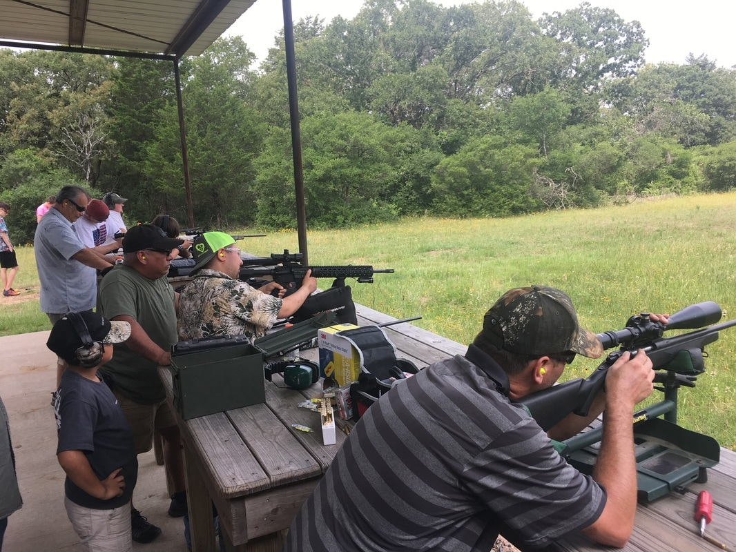 families at the shooting range