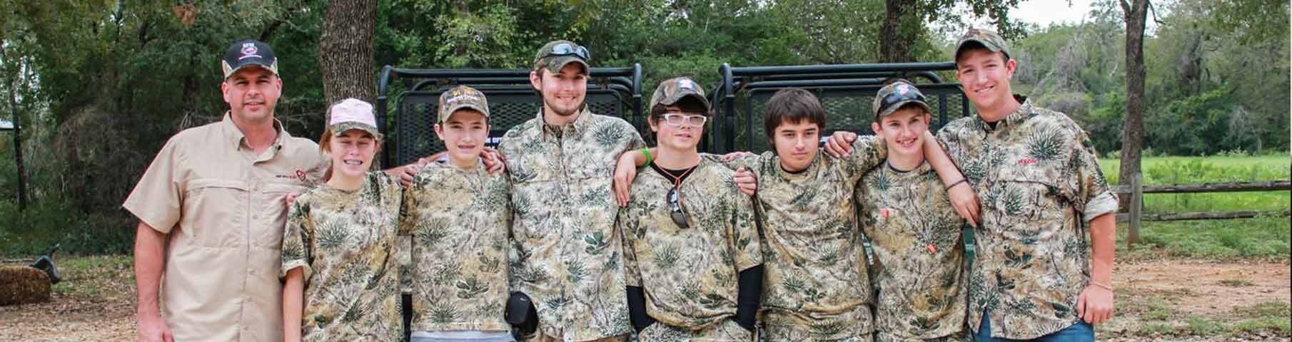 Group photo of young men from hunt with heart