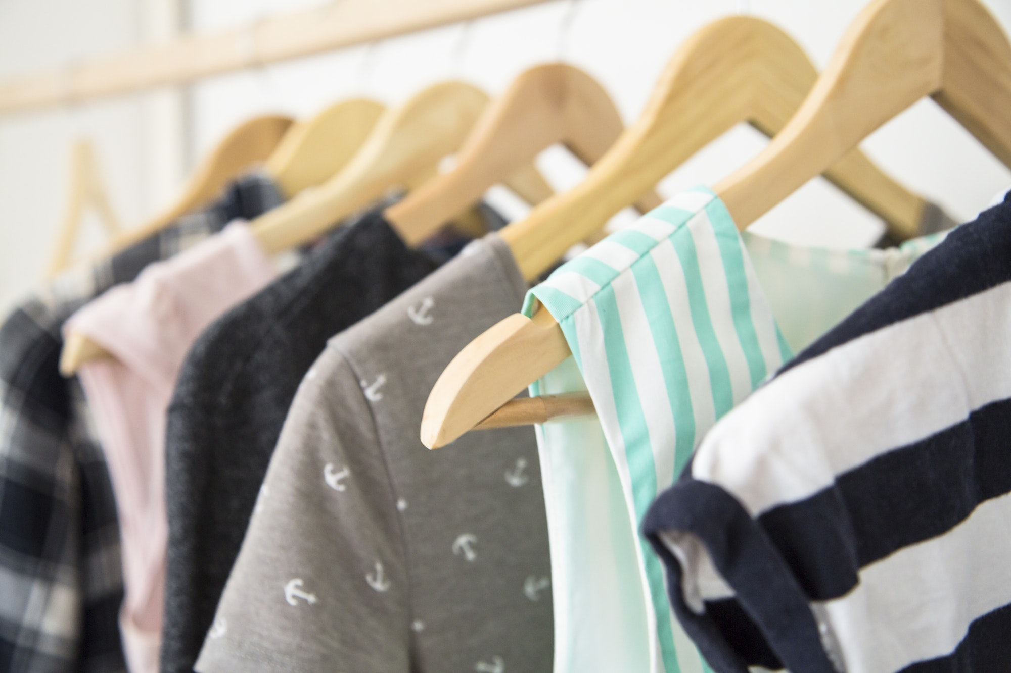 Hangers with woman clothes wardrobe