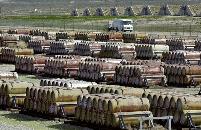A safety vehicle passing a compound filled with 170-gallon containers of mustard and blister agent at the Deseret Chemical Depot in Tooele, Utah April 30, 2001. (AP Photo/Douglas C. Pizac)