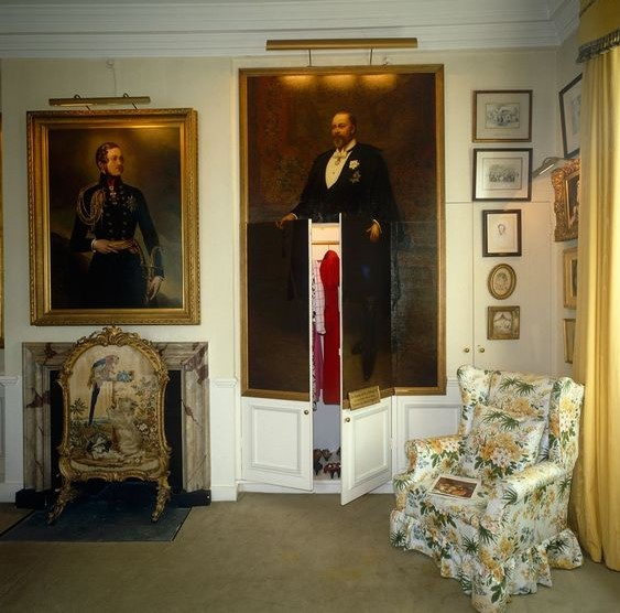 A large portrait of King Edward VII by Archibald Stuart Wortley cleverly disguises a pair of built-in wardrobe doors in the State Bedroom. Old Battersea House, London