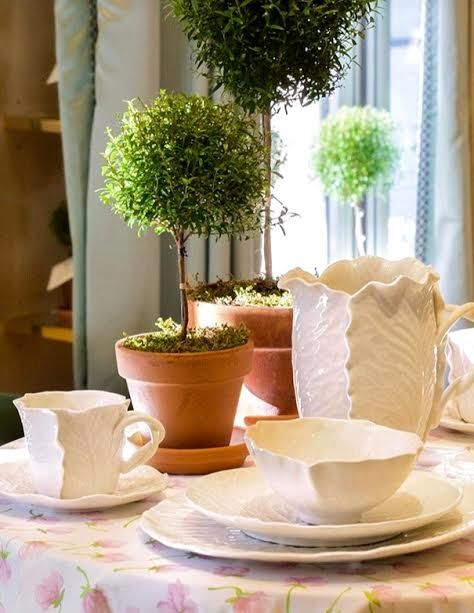 Topiaries are present in Tory's homes, stores and offices. Here are shown with Dodie Thayer for Tory Burch Dinnerware.