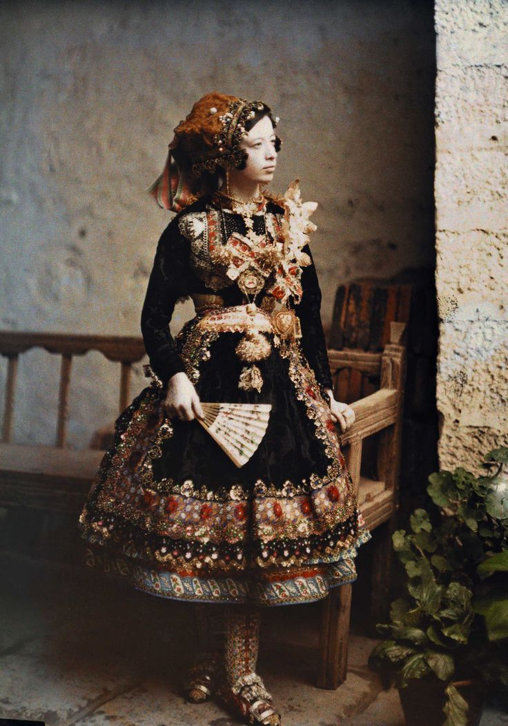 A girl from Lagartera wearing a traditional costume in 1914. Photography by Jules Gervais-Courtellemont for National Geographic
