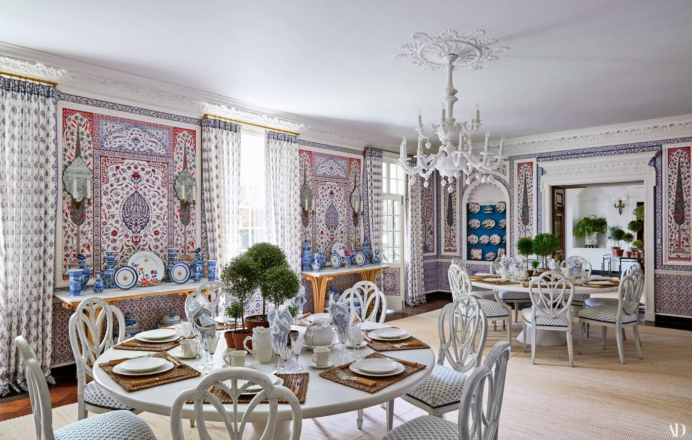 Tory Burch's dining room in her Southampton home. Iksel decorative arts on the walls