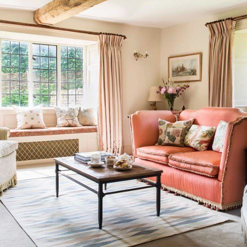 Dual aspect windows in the sitting room of one of Antonia Stewart Ltd country projects. They chose a pink/green scheme for this room to keep it fresh and warm whatever the time of the day and used different textures to create a layered, evolved feeling.