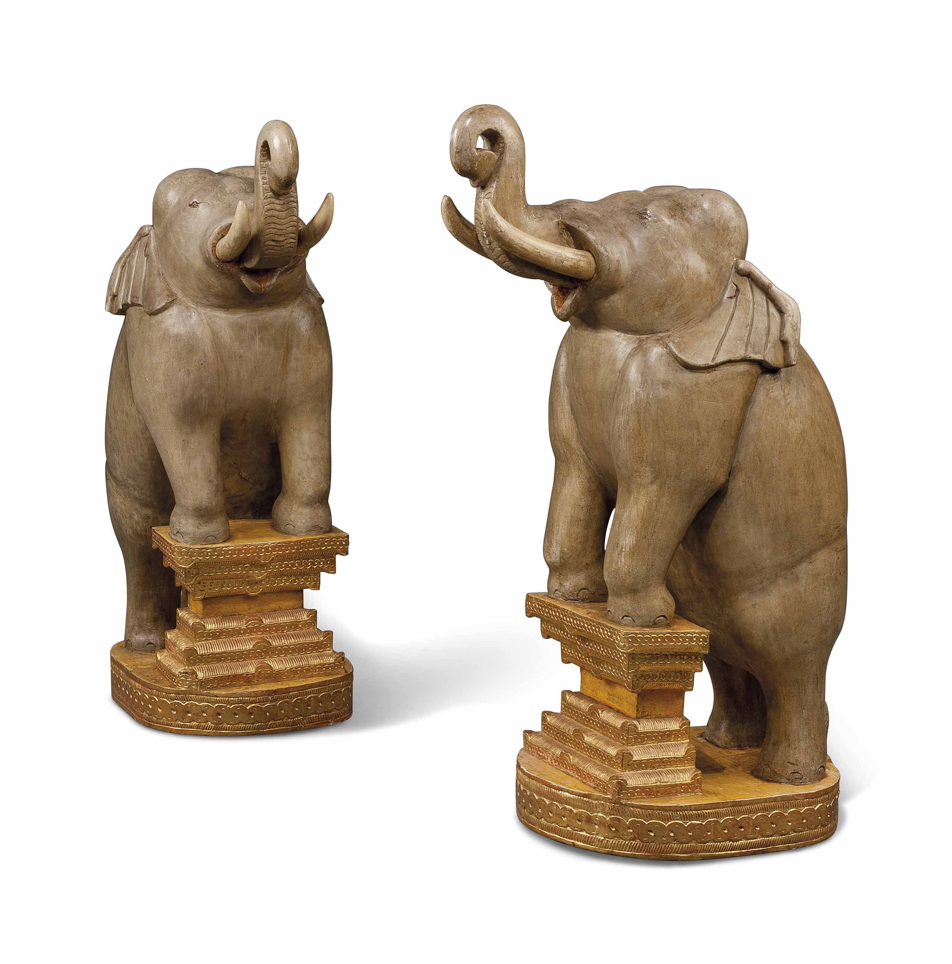 A pair of painted and parcel-gilt hardwood large elephant figures mid 20th Century, the decoration probably later. Faringdon House