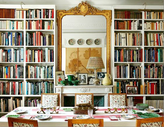 Carolina Irving's Paris dining room reveals her vast collection of reference materials, carefully organized for easy inspiration. By day, Carolina employs the space for research and work and in the evening it is home to frequent dinner parties. Jansen oak chairs are upholstered with her own Kandily pattern. Mileu Magazine