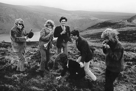Brian Jones, Nicki Browne, Anita Pallenberg and other guests stand in front of Lough Tay on the day of Tara Browne's Birthday