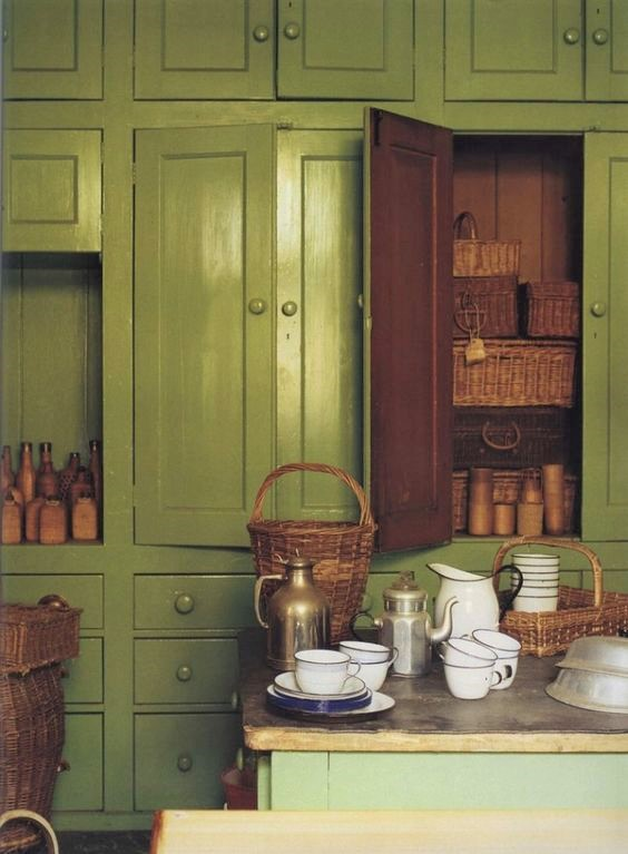 green kitchen cabinets wicker baskets the world of interiors