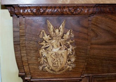 """The completed 'Coat of Arms"""" sitting on the curved cushion mantle moulding.SASPOONER"""