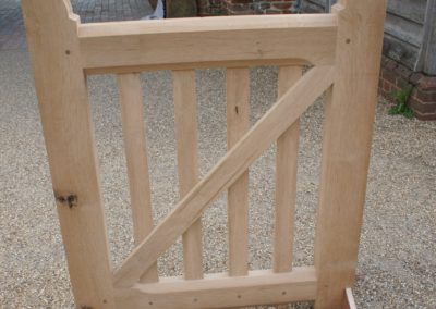 Oak side gate feathers square bar and large bevels, pegged mortise and tenonned joints.  SASPOONER