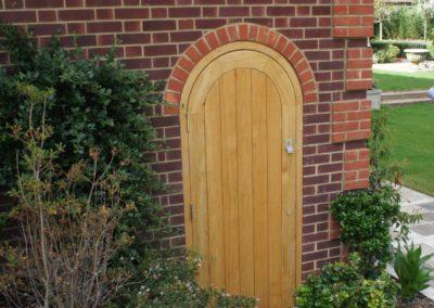 Round top Oak boarded door and frame .SASPOONER