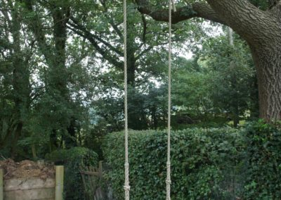 One of our swings in full glory ,Craftsmen made and the best quality materials.This swing now six years old and lives outside though winter.   SASPOONER