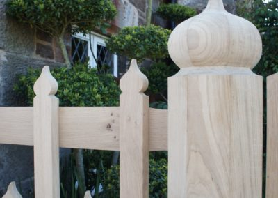 Close up of the handworked octagonal gate post and refined picket.  SASPOONER