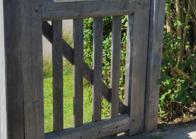 Oak side gate feathers square bar and large bevels, pegged mortise and tenanted joints, left to go grey.  SASPOONER