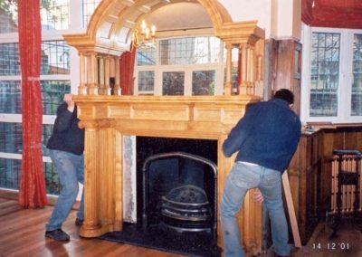 The hooded fireplace surround being fitted, The mirror has already been installed from the back.SASPOONER