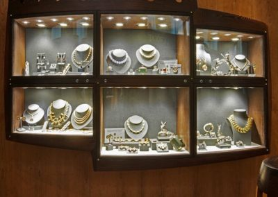 The wall display showcase made in Wenge and features curved glass.  SASPOONER