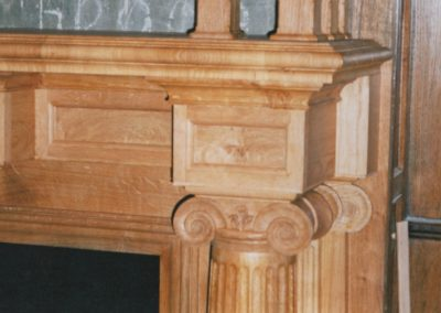 Ironic capital and close up of cross banded moulding. SA Spooner