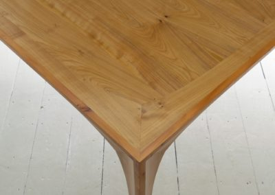 Yew wood and Cherrywood corner detail showing the curved apron reflected in the top surface mitred banding  SASPOONER