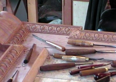 The carved mouldings being carved in after mitres cut and fitted. SASPOONER