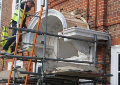 Portico being fitted after remaking and restoration.SASPOONER