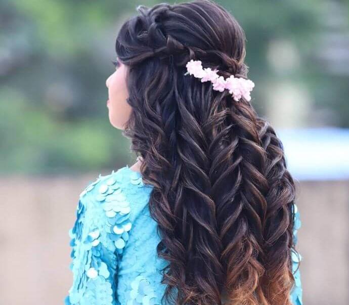 Multiple braided hair of Indian girl