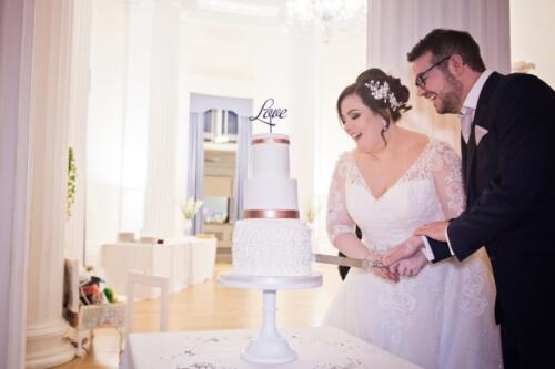 Cake Cutting. Image Credit: Blooming Photography