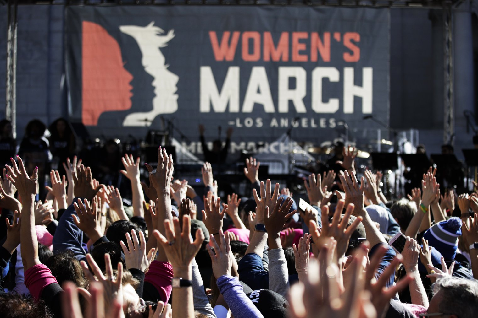 Mandatory Credit: Photo by Jae C. Hong/AP/Shutterstock (9327544a) People hold their hands up at a Women's March against sexual violence and the policies of the Trump administration, in Los Angeles Womens March , Los Angeles, USA - 20 Jan 2018