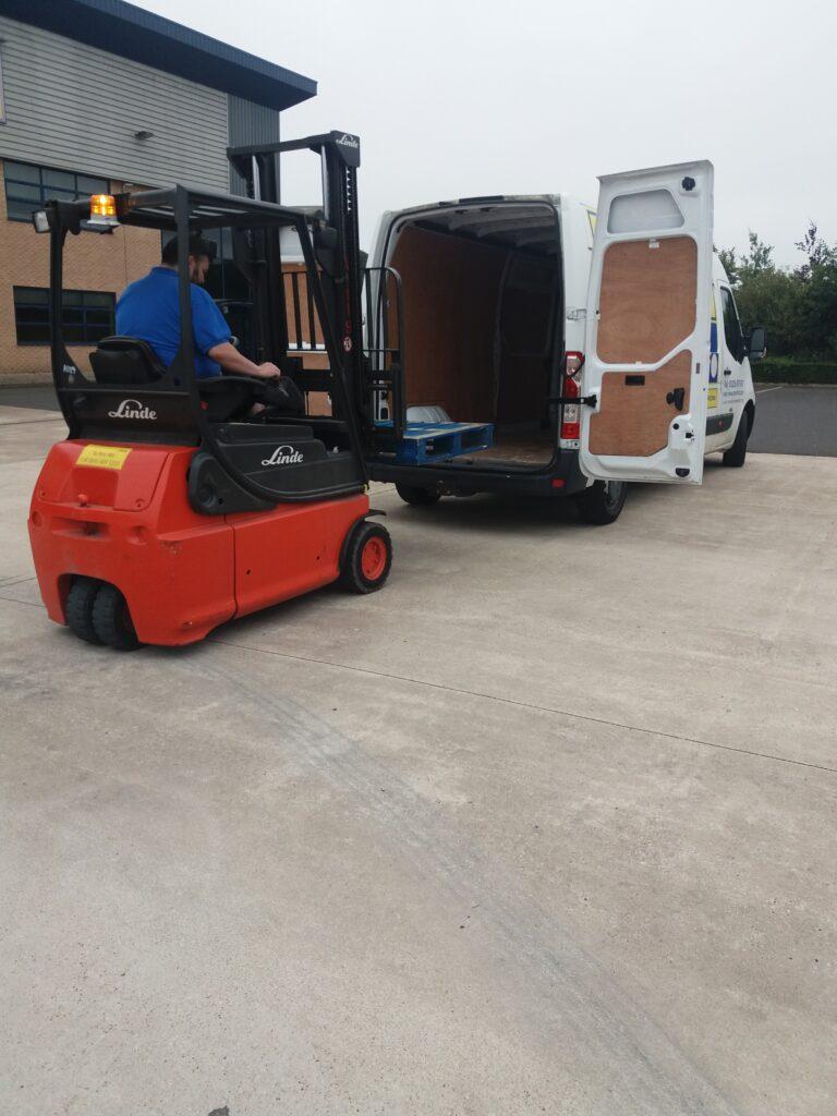 forklift driver loading a van