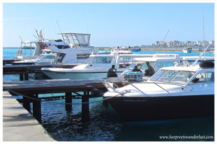Speedboats at the jetty and Male in the distance