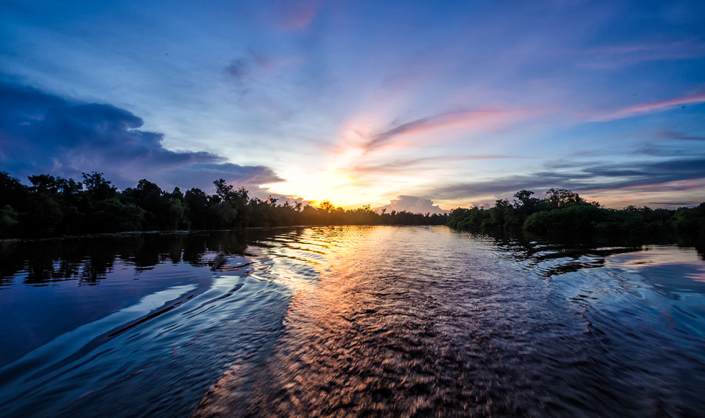 Dawn or dusk? Sunset over the  Rungan River in Kalimantan, Indonesia