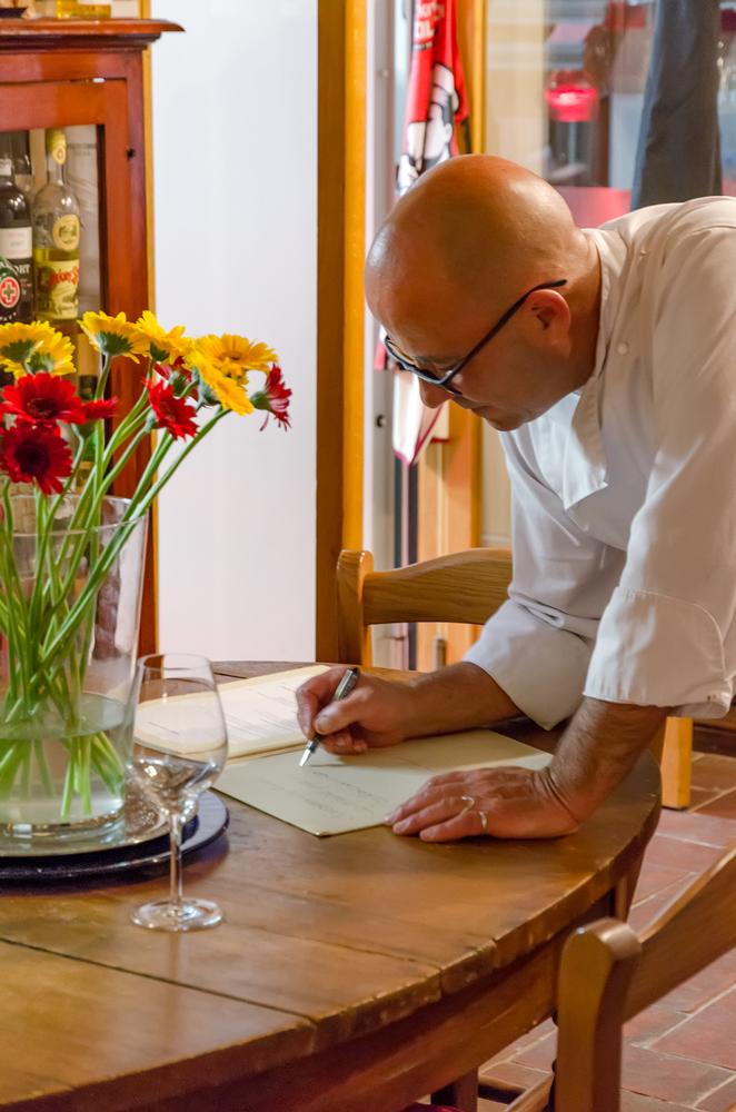 Chef signing my menu to take home!