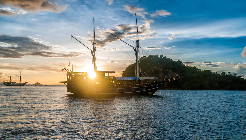 The sun sets as we come back from Komodo