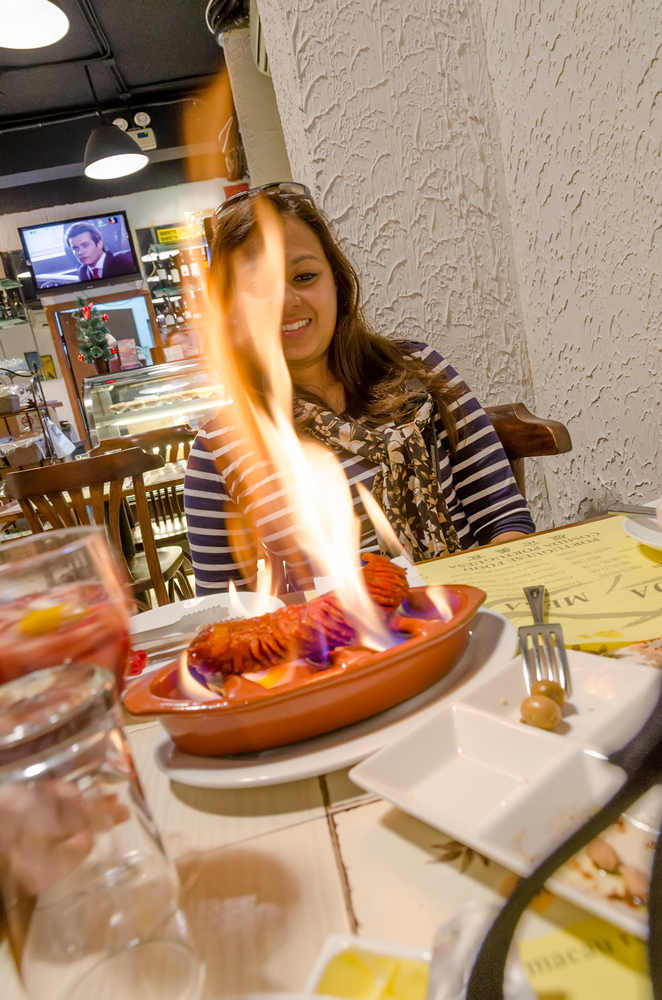 Watching the sausage being flambeed at our table!
