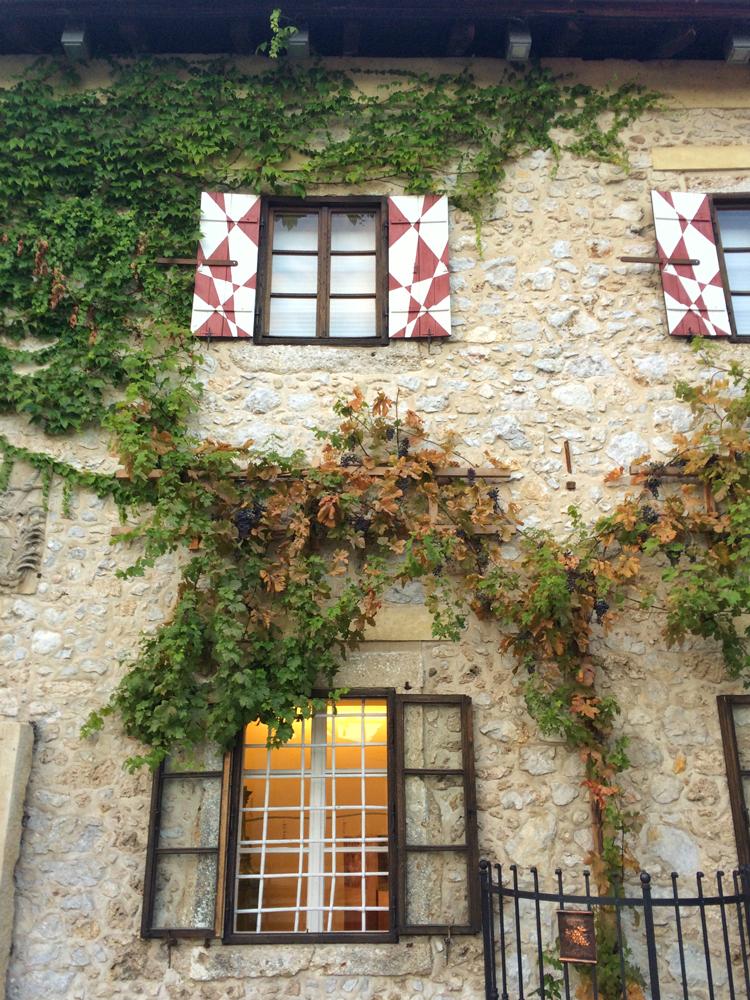 Castle walls draped with grape vines