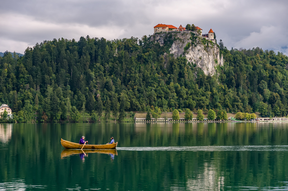 Rowing across the emerald waters of Lake Bled