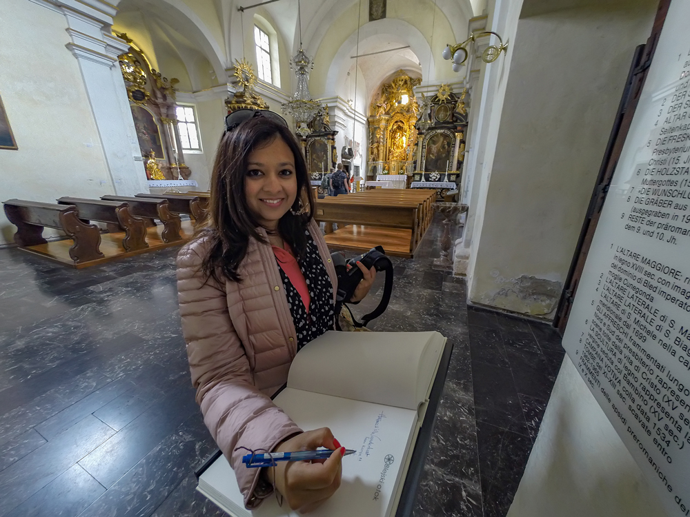 Signing the guestbook...When you go to Lake Bled, find my entry and send me a picture!
