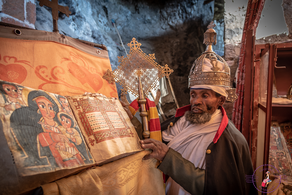 Amharic Priest and Ancient Bible at ToNeakutoleab Monastery