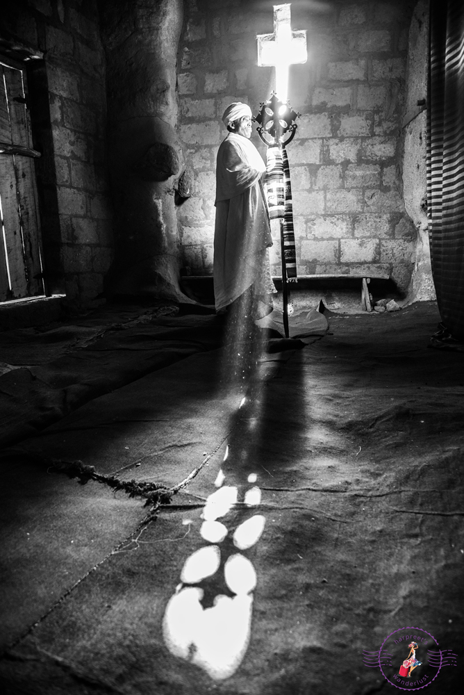 Sunlight streaming through the window and through the Cross
