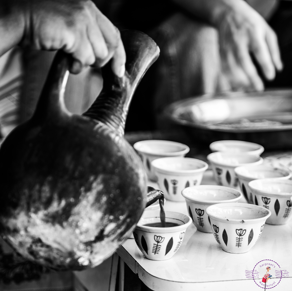 """Buna"" - coffee being poured into cups"