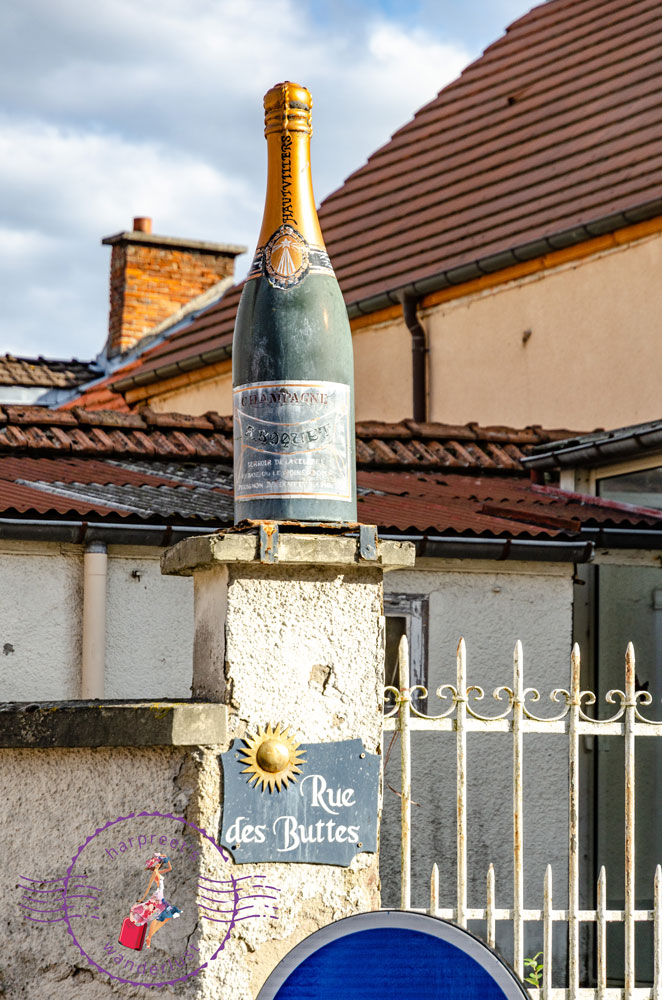 A champagne bottle on a gate in Hautvillers