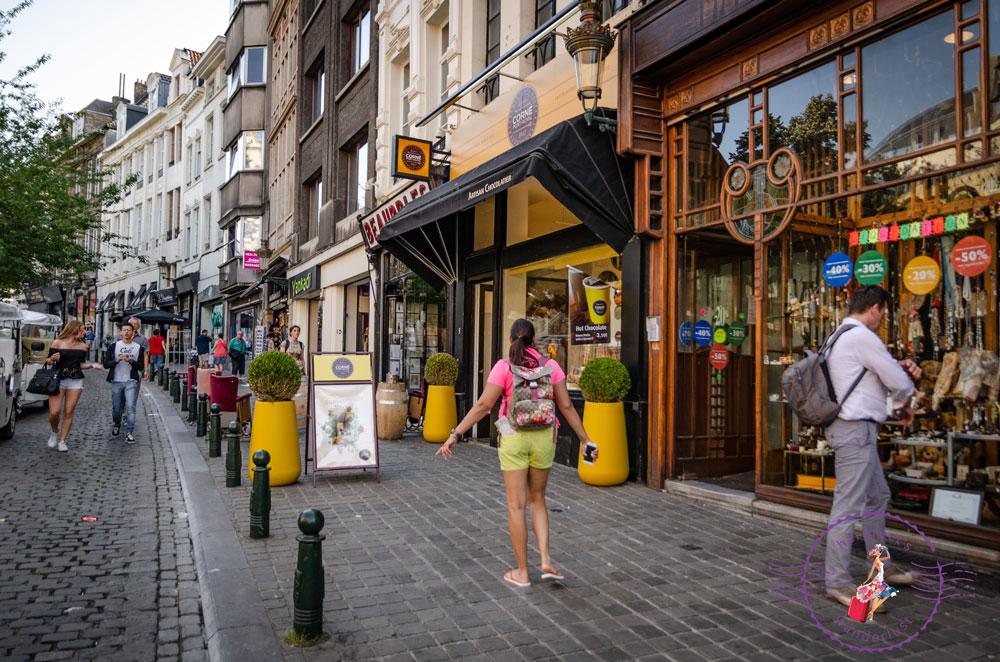Harpreet on a street in Brussels outside a chocolate shop