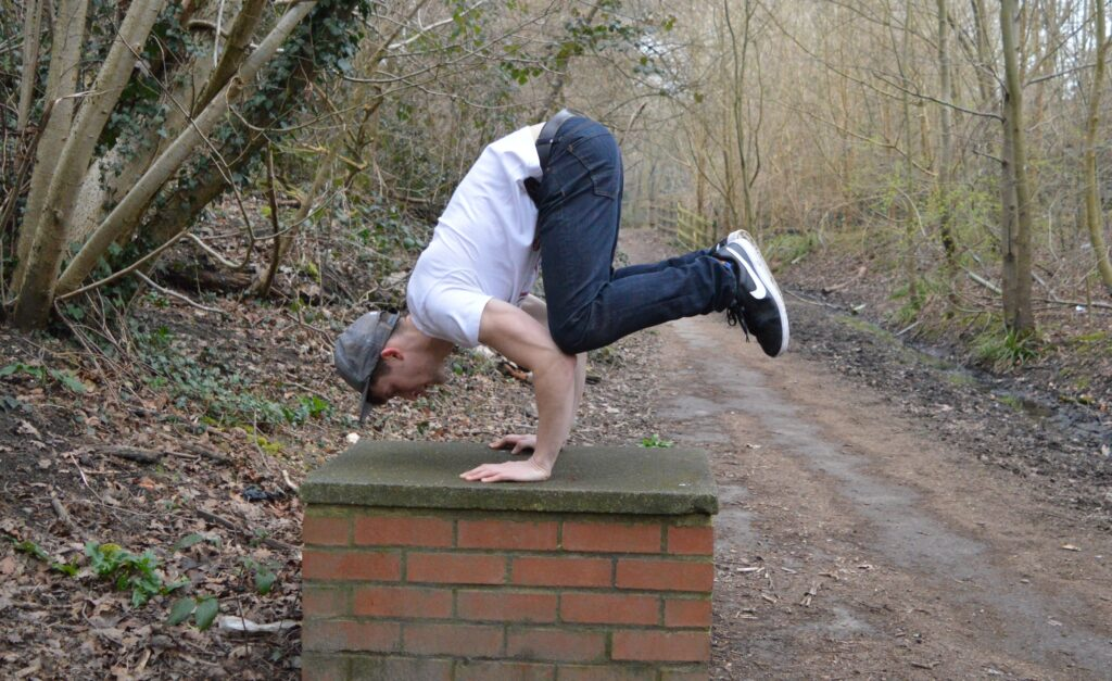 Crow Stand More Than Lifting Calisthenics Foundation Course Image beginner isometrics exercise