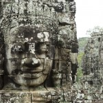 Sculpted stone heads at the Bayon temple, near Siem Riep, Cambodia. Photo by Stuart Forster.