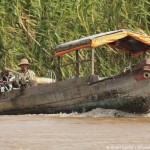 A typical wooden boat, with a face painted onto the prow, on the Mekong River near Tan Chau, An Giang Province, Vietnam. Photo by Stuart Forster.