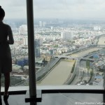A woman views Ho Chi Minh City and the Saigon river in Vietnam. She looks at the city, formerly known as Saigon, from the viewing platform of Bitexco Tower. Photo by Stuart Forster.