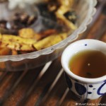A cup of lotus tea, served with regional snacks, at Cai Be, Vietnam. Photo by Stuart Forster.