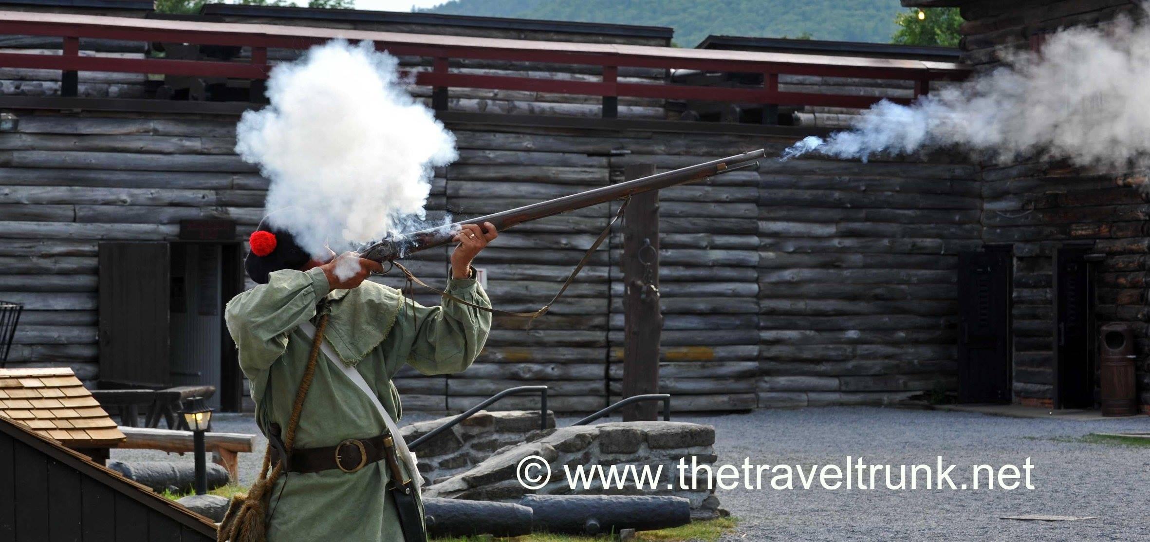 Costumed colonial American Ranger fires his gun